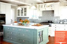 Love this painted island with the white cabinets!