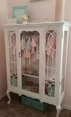 Vintage hutch turned into a child's closet. Oh. My!