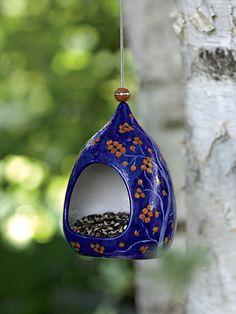 blue pottery birdfeeder