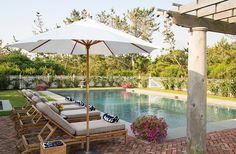 Pool with herringbone brick patio, pergola and teak chaises | One Kings Lane — Our Style Blog