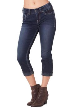 Perfect for the girl with curves the Suki mid-rise capri in ultra-comfortable Super Stretch denim is made just for you! Conforming to your natural curves without gapping in the back. Silver's Super Stretch fabric is lightweight and soft yet designed to stand up to everyday wear and tear. You'll love the vintage-inspired details like subtle distressing on the super dark clean wash. And behind it all signature stitched back pockets different for each jean and hand placed to sit just right…