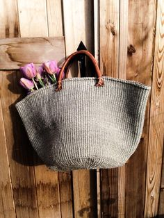"""Handmade solid grey tote 23""""W x 12"""" H. Sisal Hand-Sewn Leather Handles Each piece is unique slight variations are normal"""