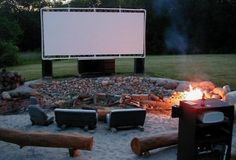 An outdoor movie screen, made with PVC pipes, tethers, and a white tarp.