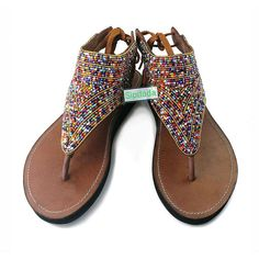 Beautiful handmade sandals made using soft high quality leather and adorned  with Maasai style beadwork.