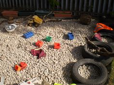 We had a wasted space in a corner. Filled it with stones and now find it lends itself to loads of applications. Here you see a builders yard small world. The children love loading the stones and even using the bricks and sticks to build their own masterpieces.