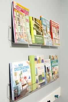 "I loved the idea of the IKEA spice racks functioning as front-facing shelves for the boys' books but they just weren't wide enough to store much. @Jen Jones from iheartorganizing (fabulous blog) repurposed acrylic card shelves for her front-facing books. At $7-16 (16""-48"") they're still a steal and the boys will be able to see the whole book cover too."