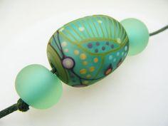 Moogin Beads light spearmint green oval focal bead by mooginmindy