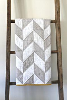 grey + white herringbone quilt
