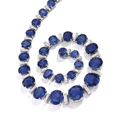 PROPERTY FROM THE COLLECTION OF LISA BLUE BARON: Platinum, Sapphire and Diamond Necklace, Oscar Heyman & Brothers. Of graduated design set with 29 oval and cushion-cut sapphires, the three largest sapphires weighing 15.30, 10.33 and 10.16 carats, the remaining sapphires ~ 106 carats, spaced by baguette diamonds ~ 6.80 carats.