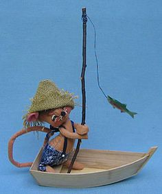 """Annalee 7"""" Fishing Mouse in Wooden Boat  Annalee Doll Description: Last one. Open eyes, tan body, brown hair, burlap hat, denim overalls, holds fishing pole with fish, wooden boat. Note: facial expression different than photo."""
