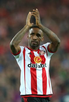Jermain Defoe of Sunderland celebrates staying in the Premier League after victory during the Barclays Premier League match between Sunderland and Everton at the Stadium of Light on May 11, 2016 in Sunderland, England.