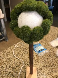 Looking for a fun and easy Spring decor item? This is a fun one! I picked up a few items at the dollar store and took them home to create my own DIY topiary. home decor dollar store How to Make a Dollar Store Topiary DIY
