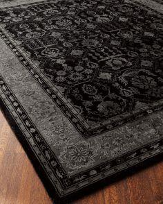 Cover your floor in a dark black rug.