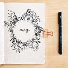 Bullet journal monthly cover page, May cover page, flower drawings, hand lettering. | @journatical