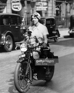 circa 1934: Nancy Debenham setting off for a motorcycle rally in Nottingham with her pet dog Bill on board. (Photo by Hulton Archive/Getty Images)  Credit: Hulton Archive / stringer