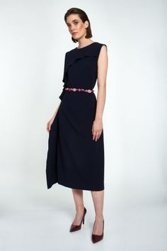 A timeless black classic with a twist. This mid-length dress is elegantly cut for a clean look, with slimming effect. The collar is embellished by hand with black, ivory and golden glass stones for a touch of color, the designer signature. 2 small delicate cuts under the collar, front and back, add further feminine subtlety. #viktoriavarga #viktoriavargabudapest #designer #hungariandesigner #handmade #ootd #outfit #black #colardress #dress #littleblackdress Mid Length Dresses, Collars, Stones, Delicate, Feminine, Ivory, Dresses For Work, Ootd, Touch