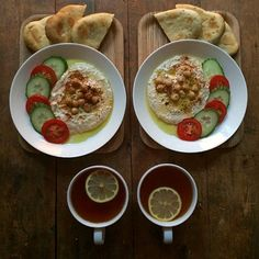 """""""Friday: Homemade caraway pitta bread with houmous, homegrown tomato, cucumber and lemon tea. #symmetrybreakfast #symmetry #breakfast #homemade #homegrown…"""""""
