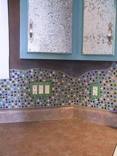 do it yourself!!! This blog is full of inspirational ideas for your home.  I love the craft beads instead of tile! Cheaper and cooler!