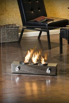 Sheer modern elegance wrapped up in a unique portable gel fireplace. Floating glass panels are held in place by a brushed nickel base that houses up to 3 cans of FireGlo gel fuel with output up to BTU each. Portable and great for indoor and outdoor use. Gel Fireplace, Fireplace Design, Small Fireplace, Bioethanol Fireplace, Fireplace Inserts, Fireplace Mantels, Portable Fireplace, Indoor Outdoor Fireplaces, Home Living