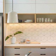geometric tile white block tile backsplash in kitchen
