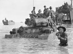Matilda tanks comes ashore at Brunei June 10 1945  Among the last of the Australian WWII landings tanks of the 2/9th Armoured Regiment come ashore at Green Beach [Maura Beach] at Brunei.  Already unloaded one of the LSI HMAS KANIMBLA [I]'s LCVPs is seen offshore in the background.