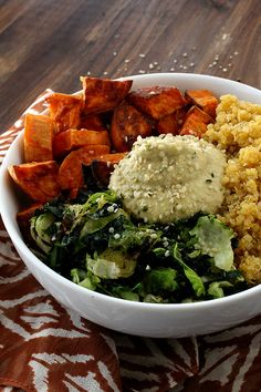 Sweet Potato Vegan Bowl with Chickpea-less Hummus - Roasted sweet potatoes, brussels sprouts, kale and quinoa, finished off with a bit of chickpea-less hummus and heart healthy hemp hearts