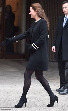 """December 8, 2014-The Duchess of Cambridge wore the """"Washington Crepe Coat"""" by Goat, with black dress underneath, and black tights, and accesorized with Episode """"Angel"""" black suede pumps, Mulberry """"Bayswater"""" clutch, Cornelia James gloves, and Annoushka pearl earrings. Her hair was in a half up-half down style."""
