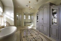 Scottsdale Elegance - Master Suite Bathroom - Custom Designed Linen cabinetry and mosaic tile rug detail.