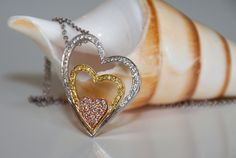 Ladies Diamond Multi-Colored Gold Heart Pendant, .60 carats of round white diamonds and .20 carats of fancy yellow diamonds set in 18ky gold.