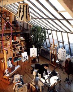 The absolute ideal studio space! High ceilings, large windows and spectacular view, lots of wood floor space as well as storage. And a loft with spiral staircase. *drool* // Artist Ruben Toledo in his NYC studio/atelier which he shares with his wife, designer Isabel Toledo.