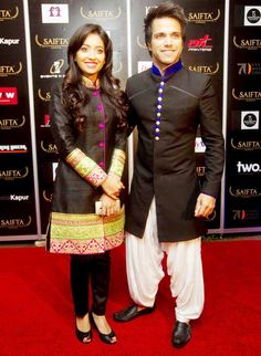 TV actor Rithvik Dhanjani wore a Jodhpuri suit seen here with Asha Negi on the red carpet at SAIFTA #Bollywood #Fashion #Style