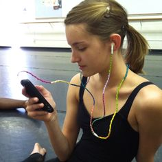 @Amanda Stambrosky models her embroidery floss wrapped head phones.