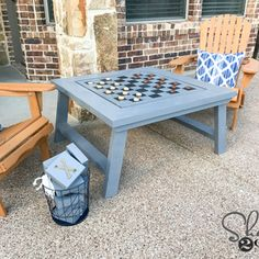 DIY Outdoor Game Table! Flip the board for tic-tac-toe. Free plans!
