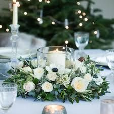 Image result for round table for 10 wedding floral centrepiece