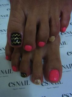 Pink pedicure with black and gold accent nails