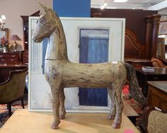 """Carved Wood Horse in Light Finish Wood with Black and Red Accents. Measures 31"""" x 29"""""""