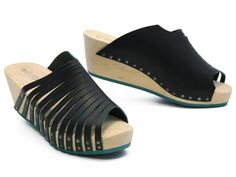 I love everything about this sandal clog: the black leather with the teal edge, the teal rubber, the teal patina on the rivets, the wooden heel, and the many, many straps! Trippen, always so good! xo, Ped Shoes.