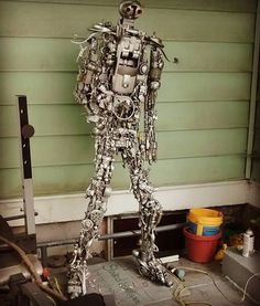 """Rise Of The Toys II""   A 6 foot robot made of toys and glue. Built to a metal frame attached to a sheet of of wood.   Look for this piece of art at Two Wolves Artist Den this First Friday Art Walk. Created by Alexander Lancaster  #art #robot #sculpture #artoftoys #toys #artshow #Topekaproud #artstopeka #artwalk #artists #artiststudio #artgallery #streetarts"