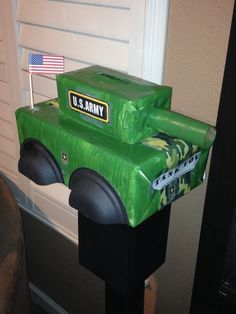 valentine mailbox. mail box that is an army tank with hinging too so valentines can be retrieved.