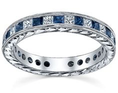 Amazing diamond and blue sapphire eternity ring with hand-engraving.  This would be a stunning wedding band.