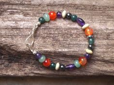 semi-precious stone bracelet with handmade hammered silver clasp.    A colourful selection of semi precious stone beads have been threaded onto