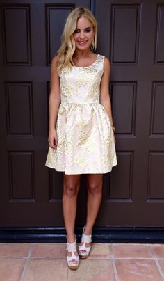 Stay golden and chic this holiday season in this metallic gold floral babydoll dress. Minimal jewelry & a pair of strappy heels is all you need to complete the look.