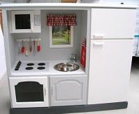 DIY old entertainment center turned into a play kitchen. Adorable!