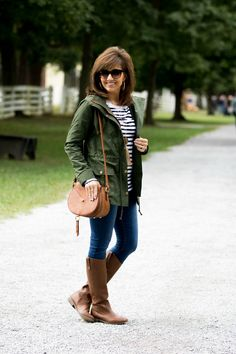 Fall uniform: skinny jeans, riding boots, striped shirt, field jacket, small bag.