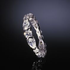 Google Image Result for http://www.adamasfinejewelry.com/SI-Sites/AdamasFineJewelry/ClientFiles/Images/products/weddingcollection/lg_wb07L.jpg