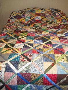 Scrappy quilt. This is absolutely beautiful!! I love the colors and pattern.