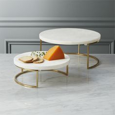 Gorgeous honed white marble floats effortlessly on a sculptural gilded base creating elegant stacked serving for parties, brunch and definitely holidays. Amazing housewarming/host gifts, too. essex servers is a exclusive. Modern Serving Trays, Serving Dishes, Marble Tray, White Marble, Home Design, Black Dinnerware, Stoneware Dinnerware, Dining Chairs, Dining Table
