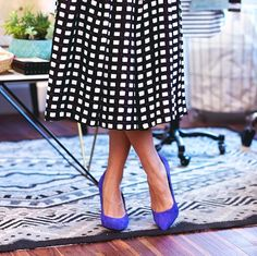 Black and white square prints with a touch of royal blue. (Source: Lace and Combat Boots)