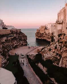 Sunset in Polignano a Mare, Puglia travel guide by Dancing the Earth Puglia Italy, Crystal Clear Water, Italy Travel, Beautiful Beaches, Cool Places To Visit, Travel Guide, Traveling By Yourself, Dancing, Earth