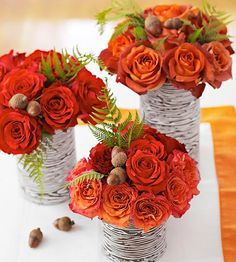 These stunning arrangments start with an unlikely material: soup cans. Simply wrap the metal cans with birch-pattern paper and glue to secure. We filled the vases with burnt-orange roses, greenery, and gathered acorns./